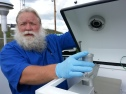 Joseph Boggs works with the PM2.5 monitor in Grayson, KY.