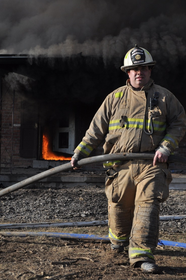 A fire-fighter drags a fire hose during the training.