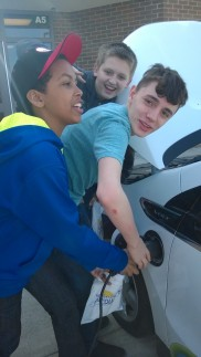 Students plug in the electric car.