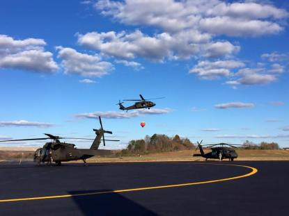 Kentucky Army National Guard Blackhawks take off with a Bambi Bucket to do a water drop. his is part of the one million gallons of water they dropped in a team effort to extinquish the fires.