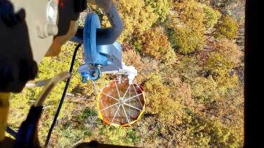 An above view of the Bambi bucket full of water before being dropped over the flames.