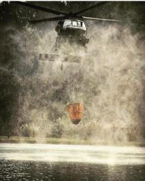 A KYANG Blackhawk picking up water.