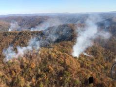 Smoke billows from various points across the landside.