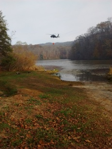 A Blackhawk filling a Bambi Bucket. Photo by Brandon Howard.