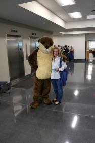 Lissa Doss and Ollie the Otter pose for a quick picture.