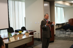 John Mura delivering his opening remarks.