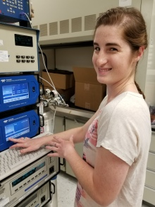 DAQ scientist Rebecca Graves works with several analyzers in the Division's lab.