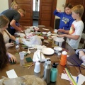 Frankfort Home School students grapple with design solutions to create their model air samplers.