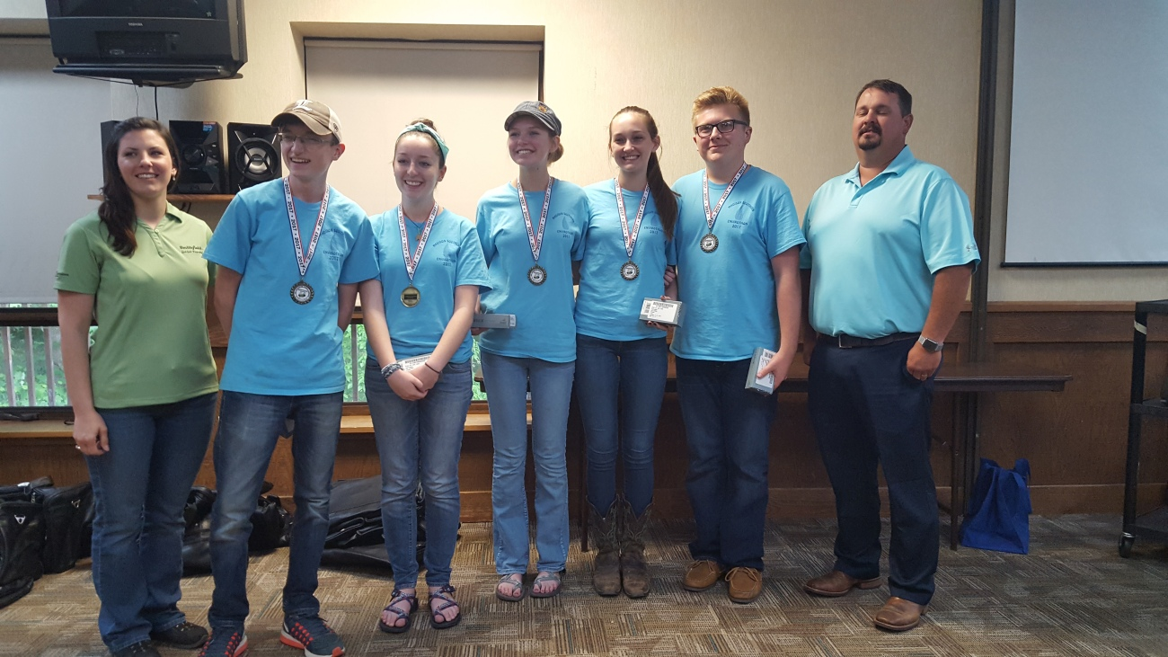 From left to right: Dorothy Anglin of Smithfield Foods poses with the Madison Southern FFA team, Seth Anderson, Callie Anderson, Lauren Rowlette, Carly Mays, Ty Allen and Jeremy Roy of the Kentucky Farm Bureau Federation . Photo by Dale Booth.