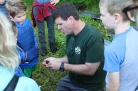 Weese holds a toad for a captive audience as hi give facts about the creature and the species. Photo by Carrie Searcy.