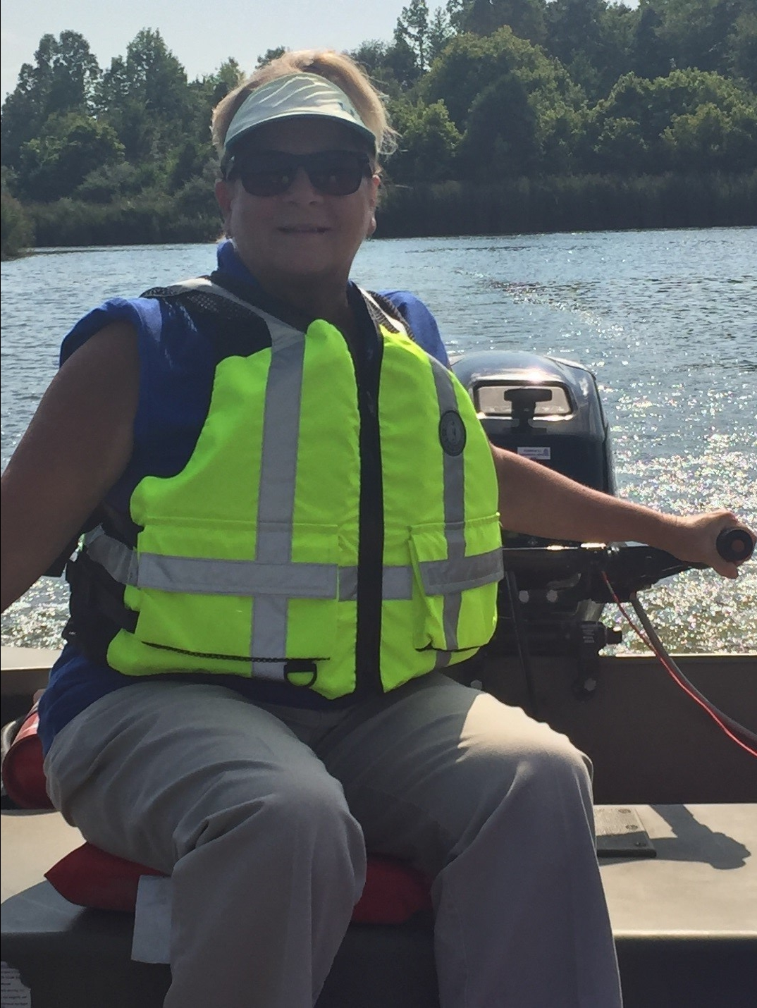 Margie Williams, one of the ERT responders from the Paducah Regional Office, operates a small outboard motor as part of her boat operator_s certification. (Photo by Kevin Strohmeier)
