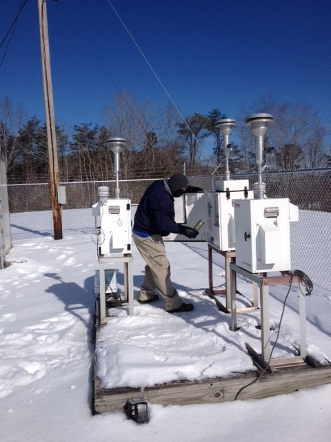 Jeff Patton works on the snowy deck with an air monitor. Photo by Joe Boggs.