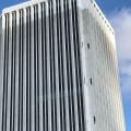 Holes punched in sides of building will aid in demolition. Photo by Roberta Burnes.