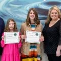Anna Carwile (center) receives her award.
