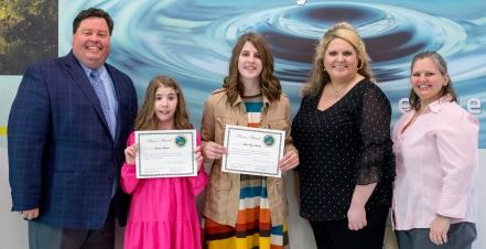 Anna Carwile (center) receives her award..