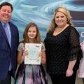 Carli Conley receives her award.