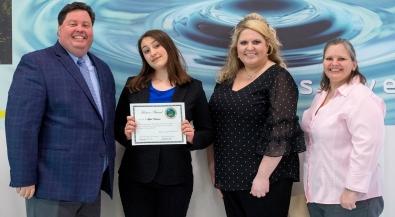 Lydia Naberhaus receives her award.