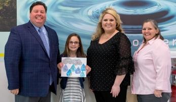 Camryn Roark receives her award.