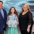 Evie Robertson accepts her award.