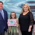Hailey Webb receives her award.