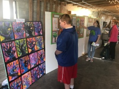 A visitor views the artwork from Stuart Home in Frankfort, Ky.