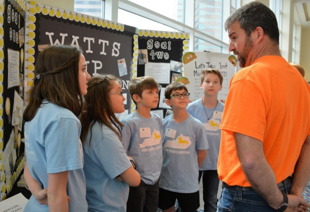 Students from Anne Mason Elementary School Explain their Kentucky NEED Energy project to a teacher from White_s Tower Elementary School.