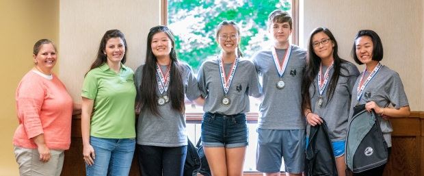 From left to right: Paulette Akers, representing the Kentucky Division of Conservation, Dorothy Anglin, representing contest sponsor Smithfield Foods, state winning team members Cici Mao, Jin Cho, Zsombor Gal, Hannah Wang and Kelly Chen.  Photo by David Hargis.
