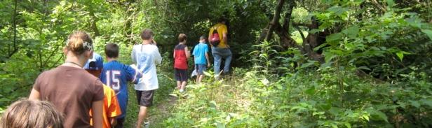 Schoolchildren experience nature at Beargrass Creek SNP by Louisville Nature Center staff.