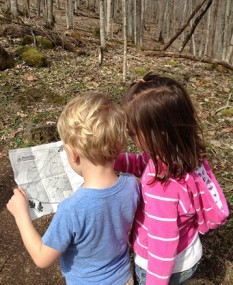 Lucy E. Braun hikers check out a map.