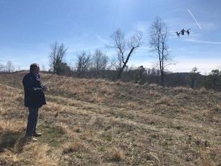 Ben Enzweiler manually lands the drone at asite.