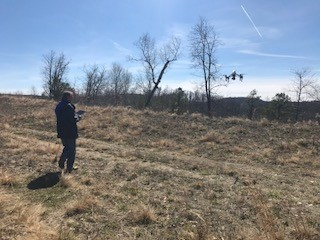 Ben Enzweiler manually lands the drone at a site.