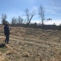 Ben Enzweiler manually lands the drone at a site.
