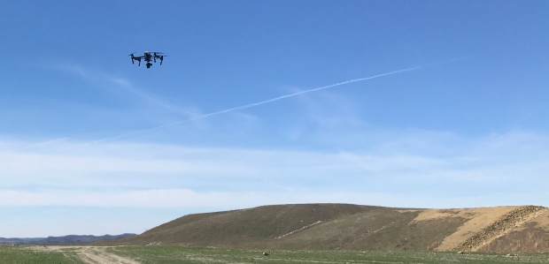 A drone takes flight at a DMRE site.